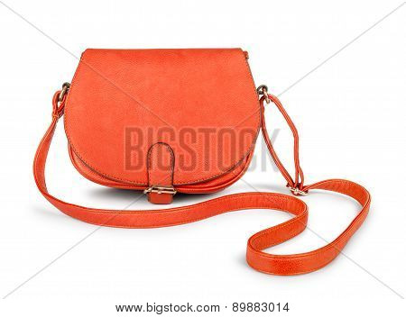 Red female leather bag falls in the air on an isolated white background
