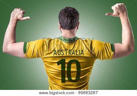 Australian soccer player on green background