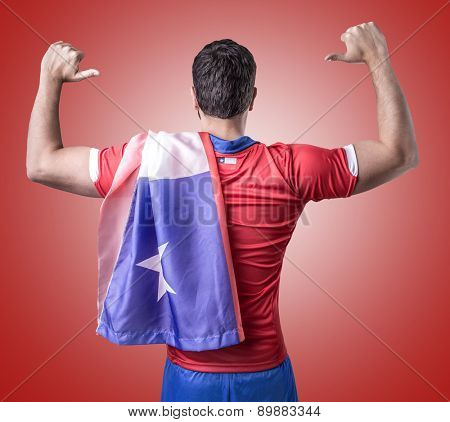 Chilean soccer player celebration on red background
