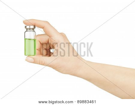 Medical Ampoule In A Hand On A White Background