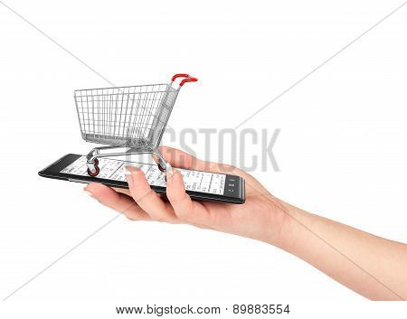 Online Shop Concept. Female Hand Holding A Phone On Which Stands Empty Shopping Cart. E-commerce.