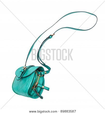 Green Female Bag Falls In The Air On An Isolated White Background