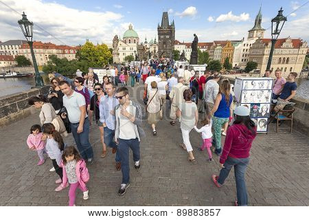Street Vendors And Tourist Walking On The Charles Bridge.