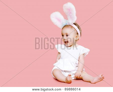Sweet Pink Cute Baby In Costume Easter Bunny With Fluffy Ears