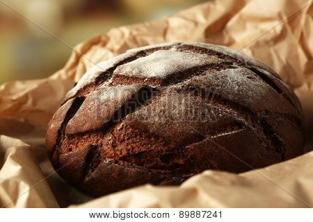 Fresh bread on paper close up