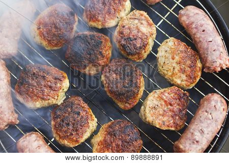 Grilled sausages and meatballs
