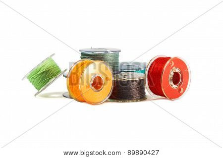 Plastic spools of threads. Colored bobbins for sewing machine.