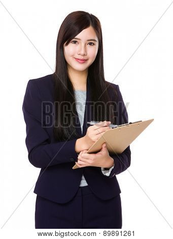 Businesswoman write on the board