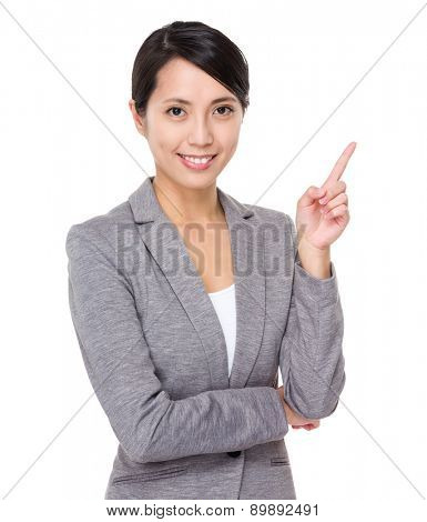 Young businesswoman with finger point upwards