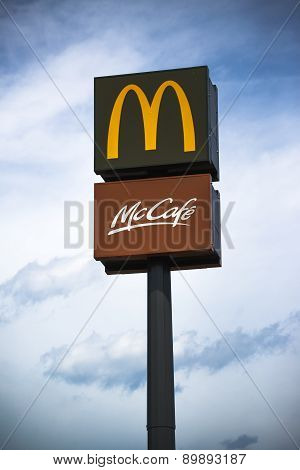 Mcdonalds And Mccafe Signs On Post