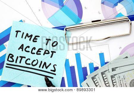 Paper with words time to accept bitcoins and graphs.