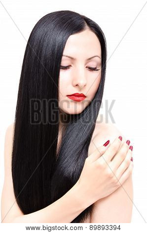 Portrait of a beautiful young woman with groomed long hair