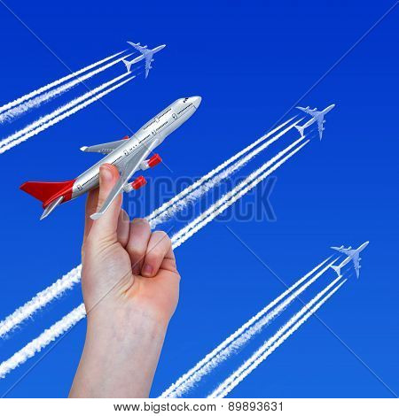 Hand holding the toy plane