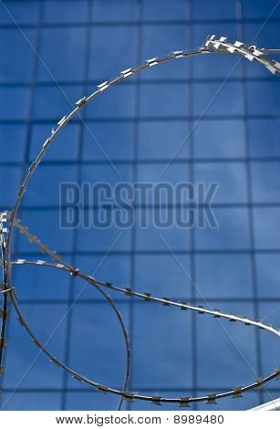 Barbed wire on a background of office building