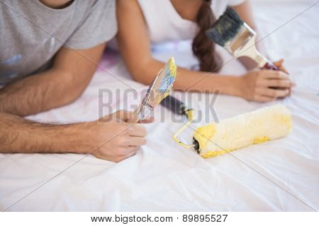 Close up of cute couple redecorating living room in their new home