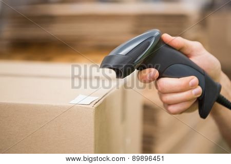 Close up of worker holding scanner in the warehouse