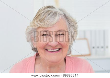 Portrait of happy female patient in clinic