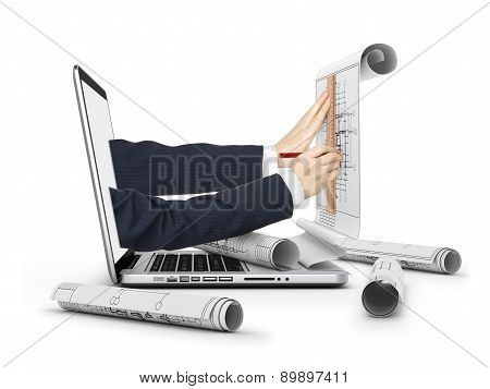 hands drawing construction plan in laptop and scrolls of blueprints