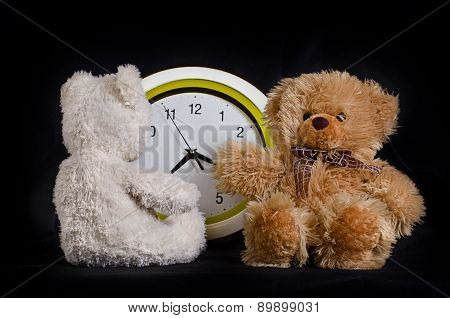 Two bear cubs toys and the clock