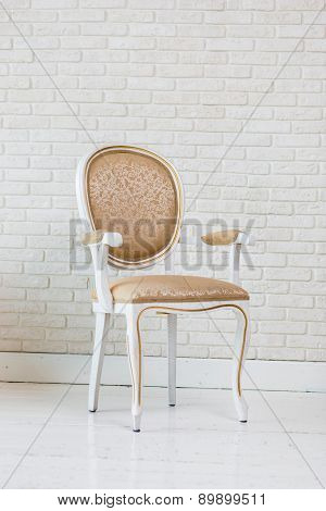 Luxury Golden Vintage Chair On Brick Wall