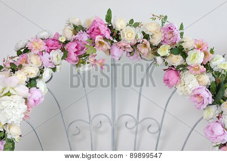 Part of wedding arch with pink and white flowers