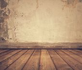 stock photo of concrete  - old room with concrete wall and wooden floor - JPG
