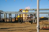 foto of gas-pipes  - Gas and oil pipes with fire - JPG