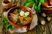 image of nettle  - Nettle soup with eggs and carrot in the bowl on the wooden table - JPG