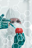 picture of medical injection  - Science and medical graphic against researcher in protective suit injecting tomato at lab - JPG