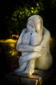 image of garden sculpture  - Graceful girl sculpture in a illuminated garden - JPG