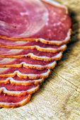 stock photo of smoked ham  - sliced and smoked ham with schwarzwald ham or prosciutto - JPG