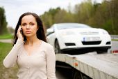 picture of tow-truck  - Woman calling while tow truck picking up her car - JPG