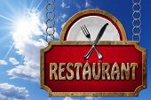 foto of food chain  - Restaurant sign with metal frame white plate with silver cutlery - JPG