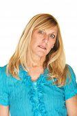 foto of tilt  - Sad single female in blue with tilted head - JPG