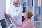 pic of visitation  - Senior woman during medical visit in doctor - JPG