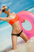 pic of lifeline  - Young beautiful brunette in sun glasses with blue glasses - JPG