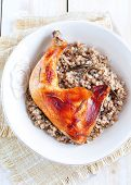 stock photo of buckwheat  - Delicious baked chicken with boiled buckwheat and rosemary sauce - JPG