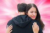 picture of girly  - Unhappy brunette hugging her boyfriend against digitally generated girly heart design - JPG