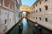 foto of gondola  - Gondolas passing under Bridge of Sighs - JPG