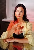 picture of bounce house  - beautiful ladylove in dress on sofa with glass of brandy - JPG
