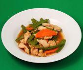 stock photo of stir fry  - chicken stir fry thai style on a green background - JPG