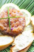 stock photo of tartar  - salmon tartar with red onion - JPG