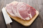 picture of pork chop  - Raw pork chop steak and cleaver on wooden background - JPG