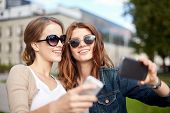 stock photo of two women taking cell phone  - summer - JPG