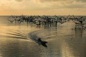 image of fishnet  - Commercial fishery use big fishnet in lake - JPG