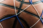 picture of netball  - Close up old basketball ball in a net background - JPG