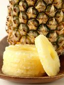 foto of dessert plate  - sweet dessert canned pineapple sliced on a wooden plate - JPG