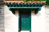 stock photo of canopy roof  - Wooden Spanish Door in the Small City - JPG