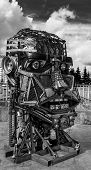 foto of scrap-iron  - Scrap metal of various shapes in a human robot face form - JPG