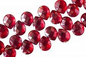 picture of beads  - Red ruby beads over white as a background - JPG